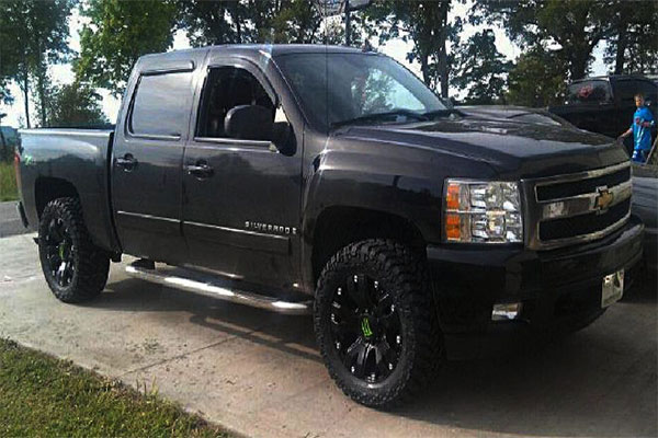 Black chevy truck with drop star wheels