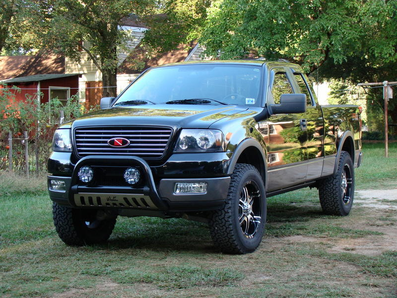 Black Ford with westin chrome bull bar