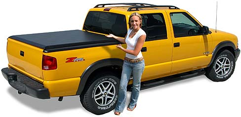 Yellow truck covered with a soft tonneau cover