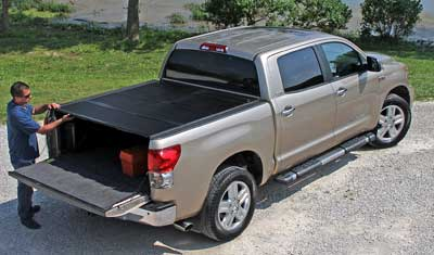 Open the tailgate with the Flex Cover closed for easy access.