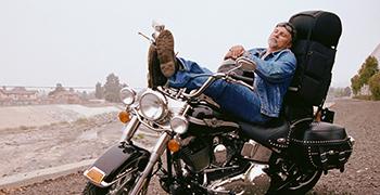 Man Sleeping On His Bike
